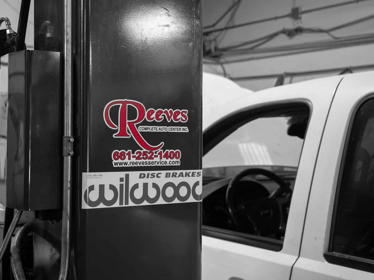 Reeves logo on pillar with truck in background