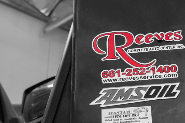 Reeves logo sticker on pillar in auto shop banner image