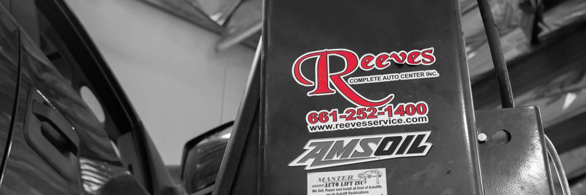 Reeves logo sticker on pillar in auto shop banner image