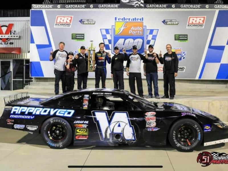 number 14 car winner circle with team and trophy