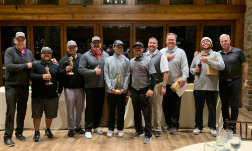 10 men posing with their awards from the 2019 Reeves Complete Auto Center golf tournament