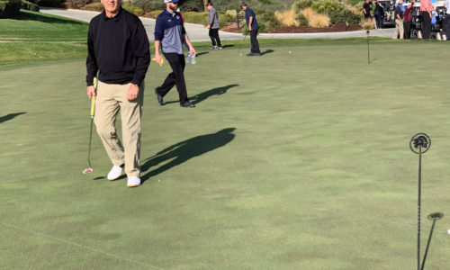men walking across the golf green at the 2019 Reeves Complete Auto Center golf tournament