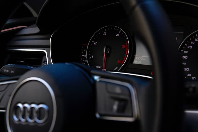 close up photo of an audi steering wheel