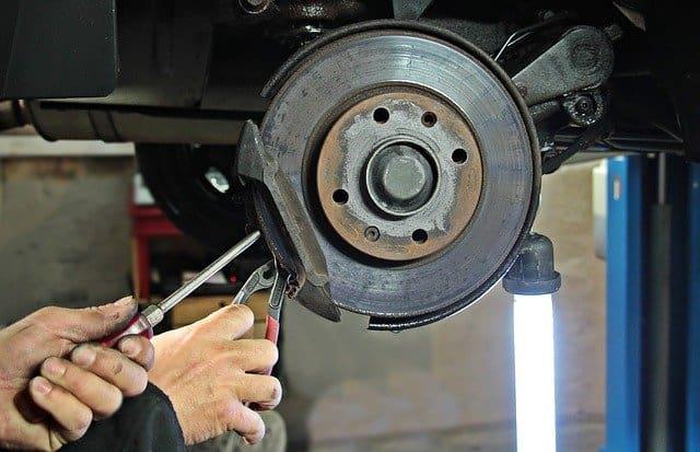 mechanic performing a brake repair